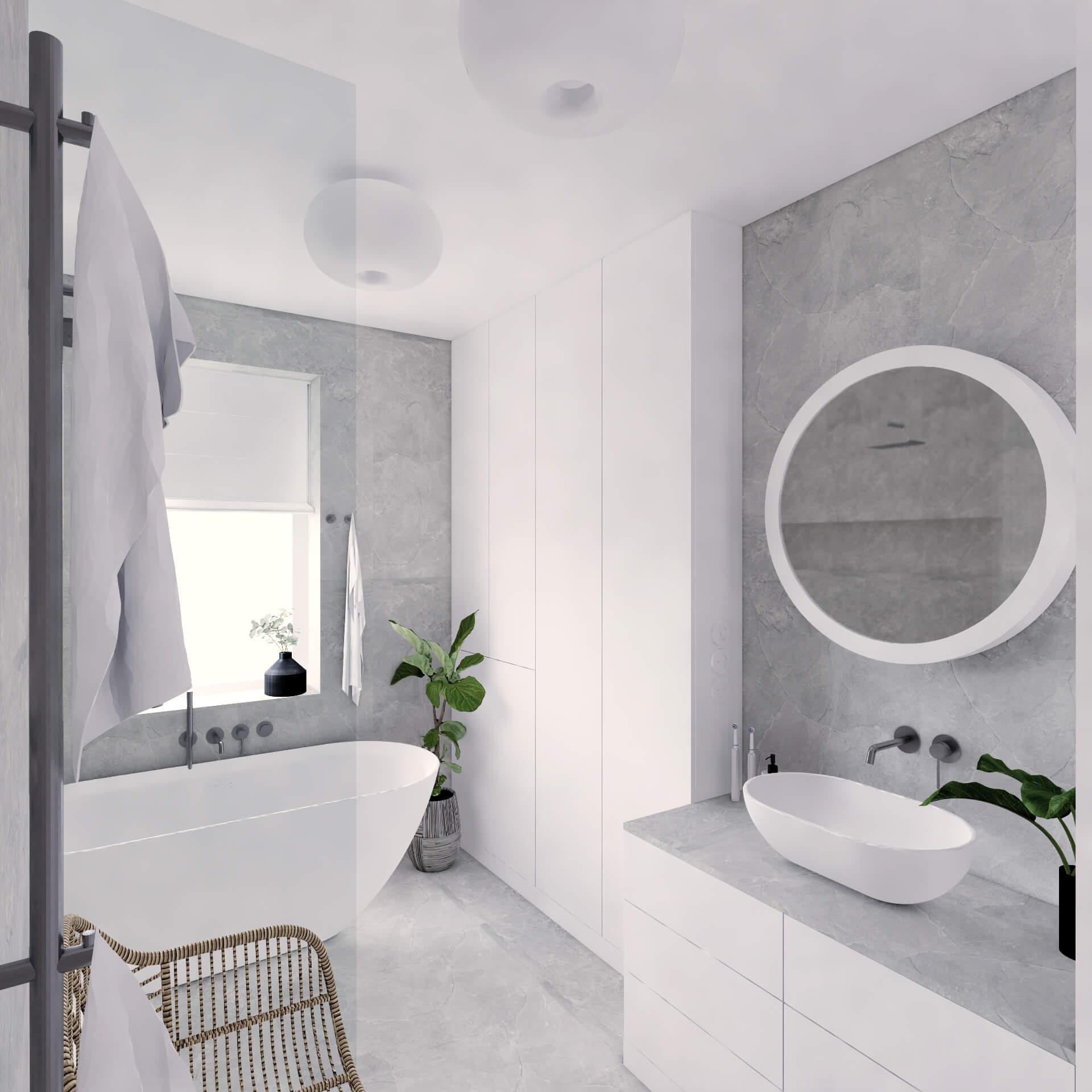 Projekt wnętrza mieszkania wraz z nadzorem nad realizacją. Łazienka w mieszkaniu 71 m2. Założeniem projektu jest prosta, spokojna przestrzeń w stonowanych kolorach. Ponad połowę łazienki wypełniają wygodna, duża wanna i obszerny prysznic typu walk-in. Mimo to jest tu dużo miejsca do przechowywania. Łazienka jest bardzo minimalistyczna – mamy tu tylko trzy kolory: biel mebli, szarość strukturalnych płytek i chrom na armaturze. Rattanowy fotel i zieleń w różnych zakątkach ocieplają wnętrze.